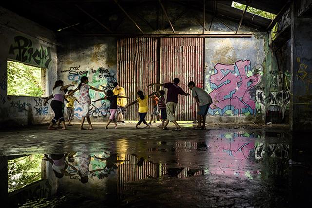 Children of Kolkata, part of the local skateboarding community, learn hip-hop dance steps in a derelict building, Kolkata Skateboarding, Kolkata, India